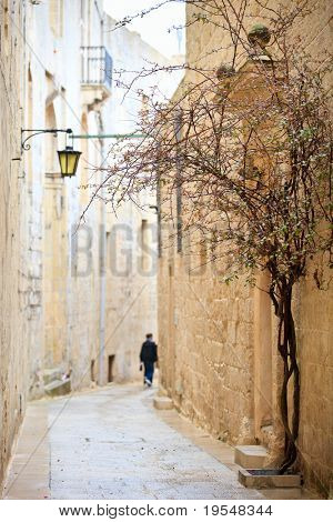 Quiet medieval stone paved street in Mdina the former capital of Malta