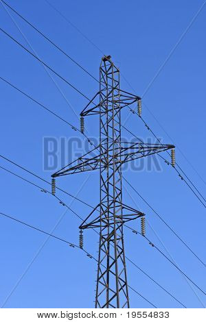 Power transmission lines and tower on blue sky background