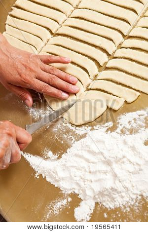 Hands Of A Woman Preparing Cookies