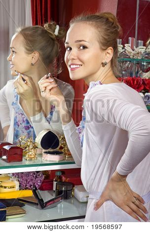beautiful woman in front of mirror in dressing room
