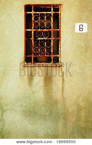 Old Grungy window with textured concrete background