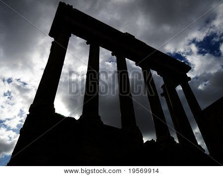 Silhouette of ancient surviving Roman Temple in Rome, Italy