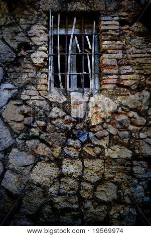 Grungy old textured window from a medieval italian village