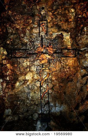 Old iron, christian cross from medieval italian mountain village, grungy, textured background