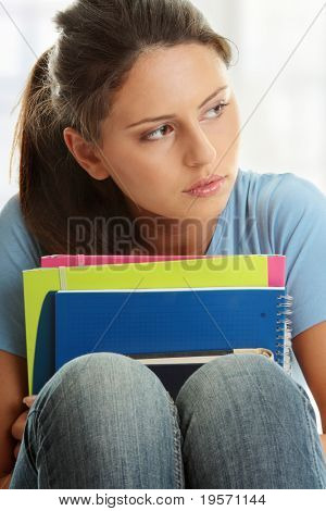Young beautiful student woman with depression
