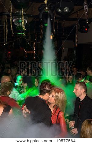 Foggy nightclub dance crowd