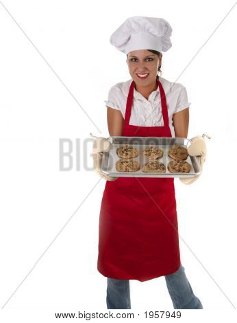 Woman In Apron Baking Cookies