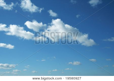 blue sky background with white clouds. Ideal for nature,health,sport or holiday designs