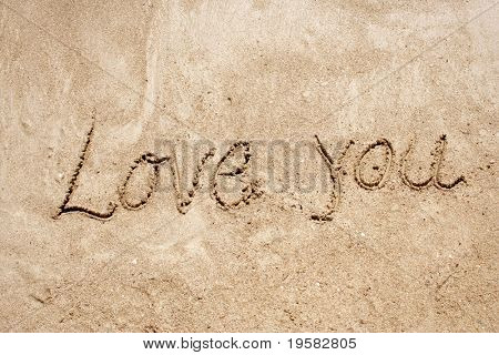Love you handwritten in sand for natural, love,tourism or conceptual designs