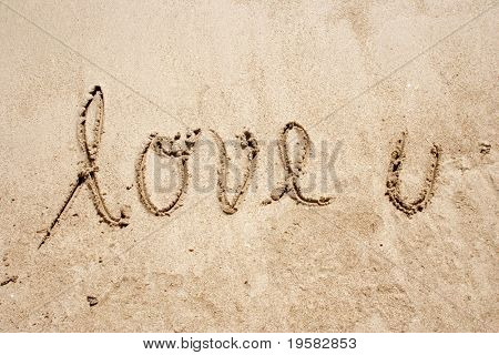 Love u handwritten in sand for natural, symbol,tourism or conceptual designs