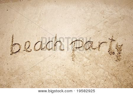 Beach party handwritten in sand for natural, symbol,tourism or conceptual designs