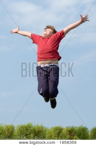 A Little Boy Jumps