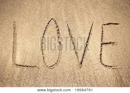 Love handwritten in sand for natural, symbol,tourism or conceptual designs