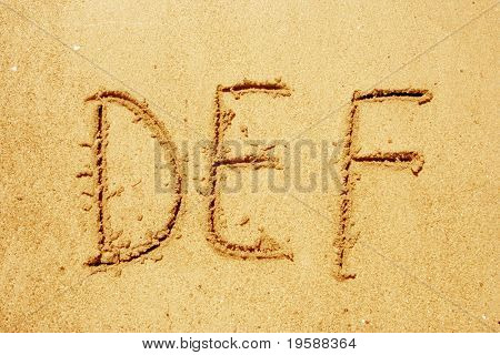 Alphabet letters DEF handwritten in sand ideal for font, nature or conceptual designs