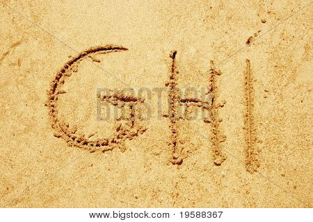 Alphabet letters GHI handwritten in sand ideal for font, nature or conceptual designs