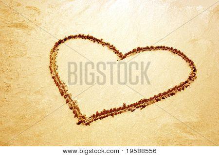 Heart shape drawn in sand on a beach