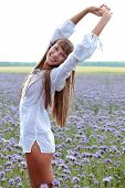 pic of hands up  - Portrait of a beautiful woman on a green meadow with hands up - JPG