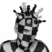 stock photo of battlefield  - young male with chess king head with clipping path - JPG