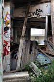 pic of asbestos  - Broken cement asbestos roofing in derelict house - JPG