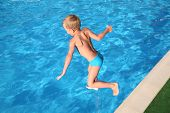 The Boy Jumps In Pool