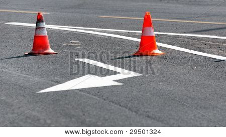 Road Block With White Arrow Showing The Alternate Way