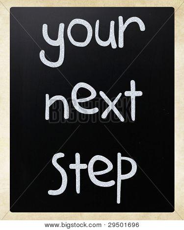 """your Next Step"" Handwritten With White Chalk On A Blackboard"