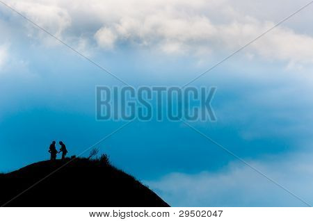 A Couple Reached The Peak Of The Mountain