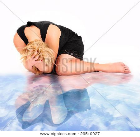 A picture of a frustrated woman and her water reflection lying over white background