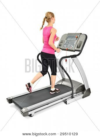 young woman doing exercises on treadmill, on white background, some blurred motion