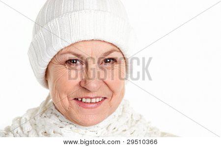 Smiling mature woman in winter cap
