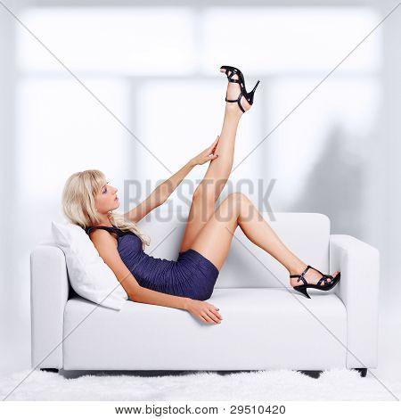 Blond Girl On Sofa