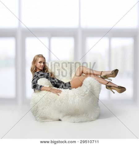Girl Sitting In Arm-chair
