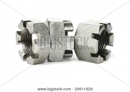 Three Hexagonal Metal Nuts on White Background