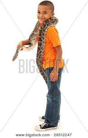 Adorable Young Black Boy Holding pet Boa Constrictor Over White Background.