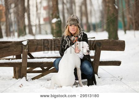 Outdoor Winter Portrait Of Blond Young Woman And Dog
