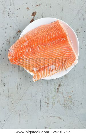 Big Raw Salmon Steak In White Plate On Rustic Table