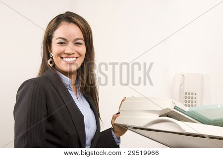 Pretty Businesswoman Making Copies