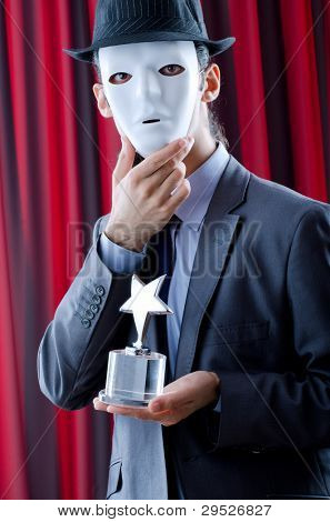 Man receiving award in mask