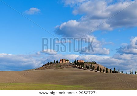 Farmhouse in Tuscany on a hill