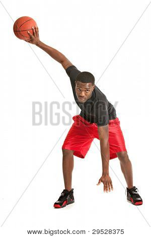 Young Black College Student Playing Basket Ball on Isolated White Background