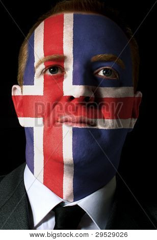 Face Of Serious Businessman Or Politician Painted In Colors Of Iceland Flag