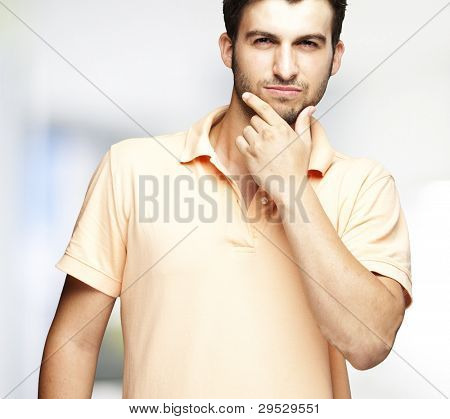 portrait of a young man thinking indoor