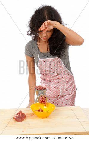 Beautiful Housewife Cutting Meat