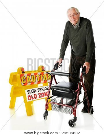 "A senior man happily passing a ""Caution, Slow Senior"" sign with his wheeling walker.  On a white background."