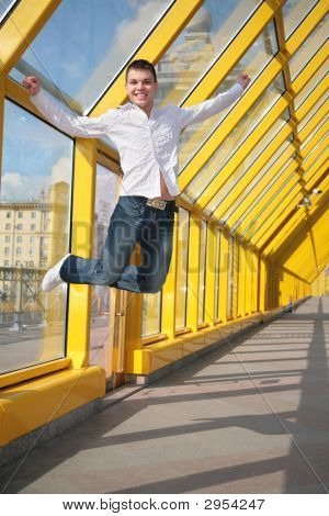 Young Man Jumps On Footbridge