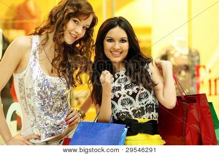 Portrait of two stylish women looking at each other at meeting in shop