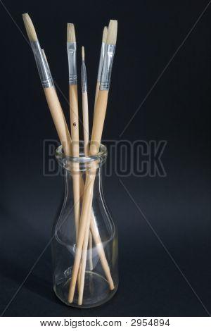 Artist'S Brushes In Old Milk Bottle