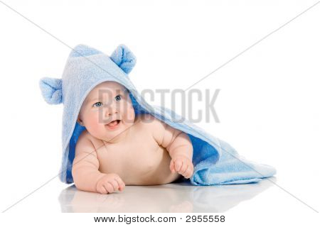 Small Smiling Baby With A Towel