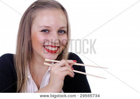 girl with sticks for the Chinese meal