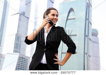 business woman on the phone at modern building